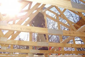 Volunteer installing roof trusses