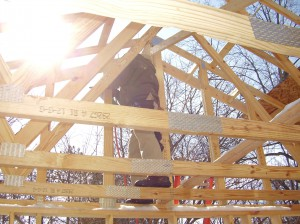 Volunteer installing roof trusses